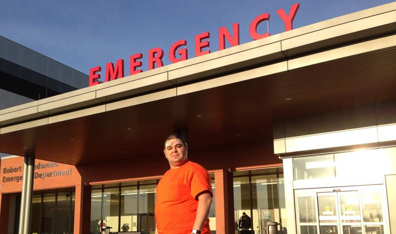Dr. Rafi Setrak, Chief of Emergency, St. Catharines Site, in front of the new St. Catharines Site ED with the unveiled Emergency sign this morning.
